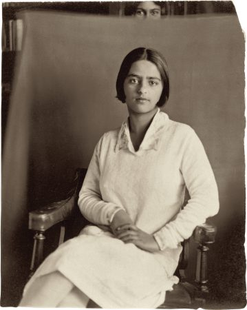 Amrita seated with Indira holding cloth backdrop c. 1928, L'Holme, Simla, India Vintage print, 8.9 cm x 7.2 cm   Inscribed on reverse by Umrao Singh Sher-Gil:Amrita in Simla 1928-?